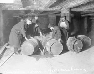Prohibition agents destroying barrels of alcohol